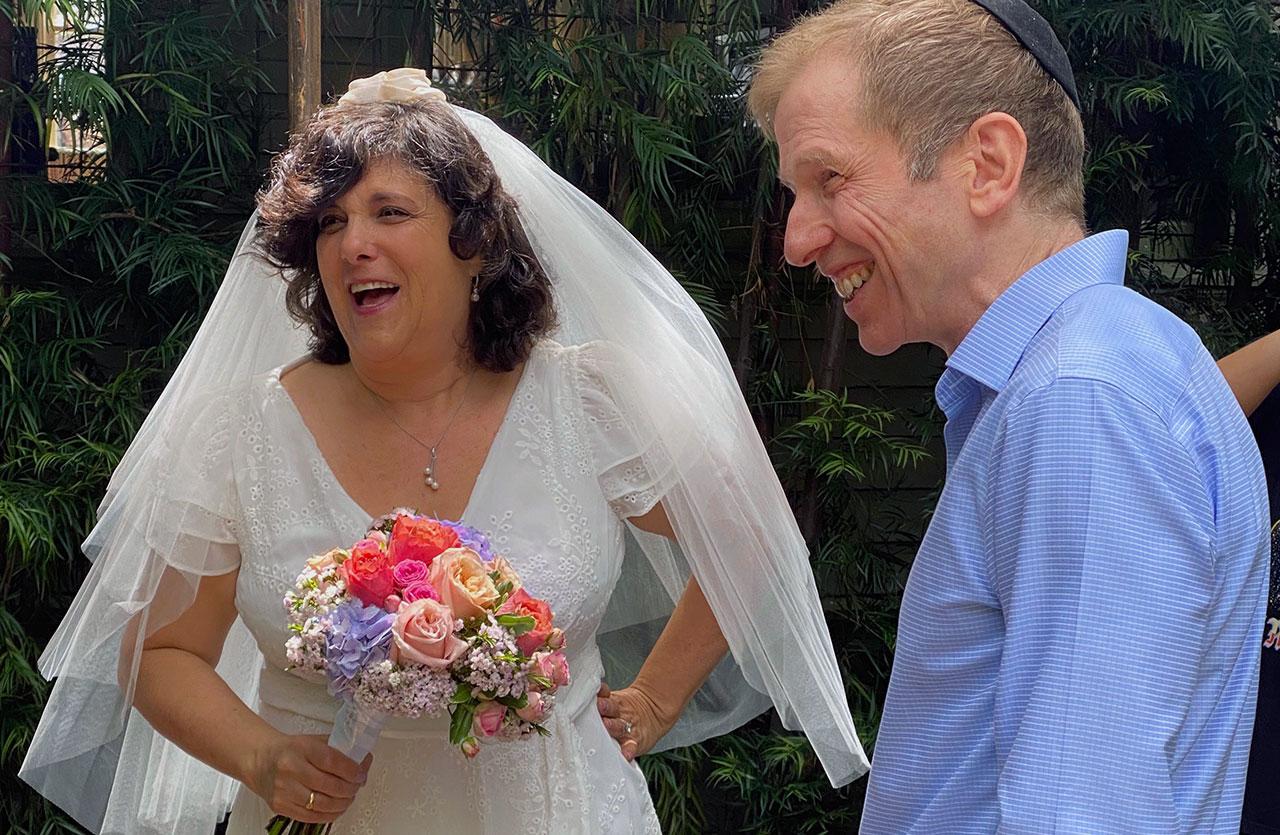 Judy Penso and Marc Manason enjoying their wedding day, April 30, 2021. (Photo/Lisa Sibony)