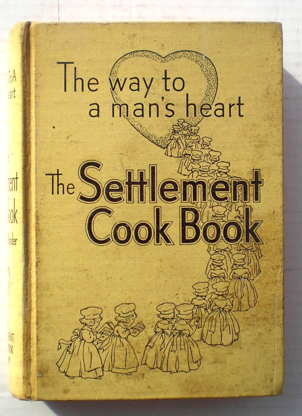 A yellow book cover with the title and an image of a heart