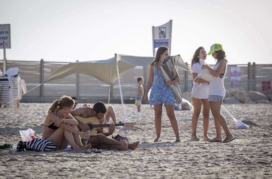 Israelis enjoy the warm weather on the beach in Tel Aviv, October 03, 2016. Photo by Nati Shohat/FLASH90