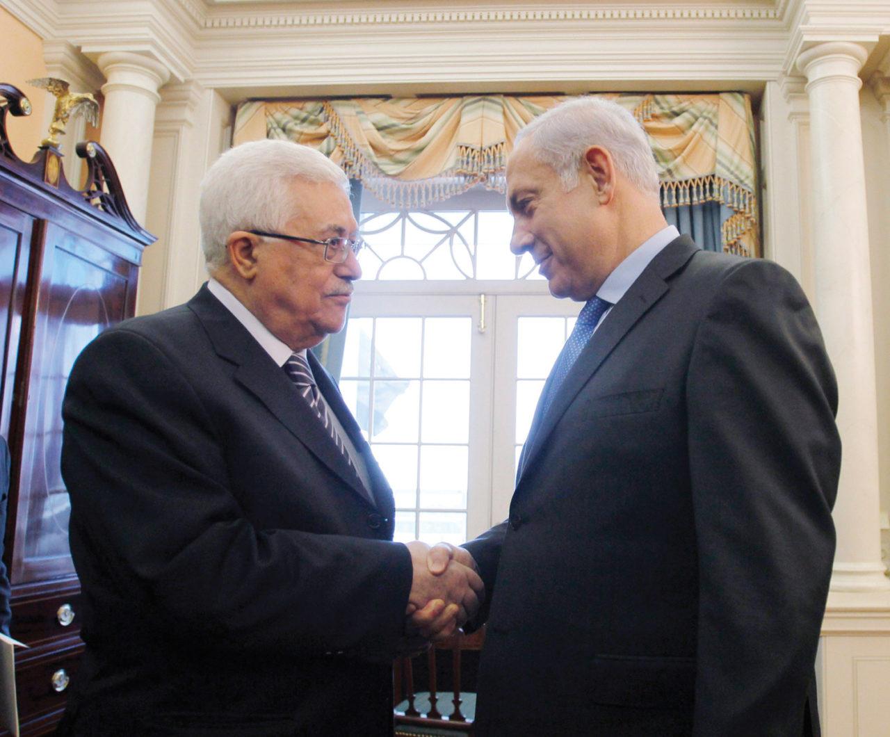 Palestinian Authority President Mahmoud Abbas (left) and Israeli Prime Minister Benjamin Netanyahu before direct peace talks in Washington, D.C., in Sept. 2010 (Photo/JTA-Getty-Jason Reed-Pool