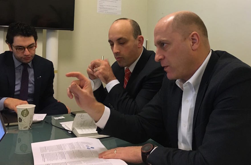 grinstein and greenblatt seated at a table talking
