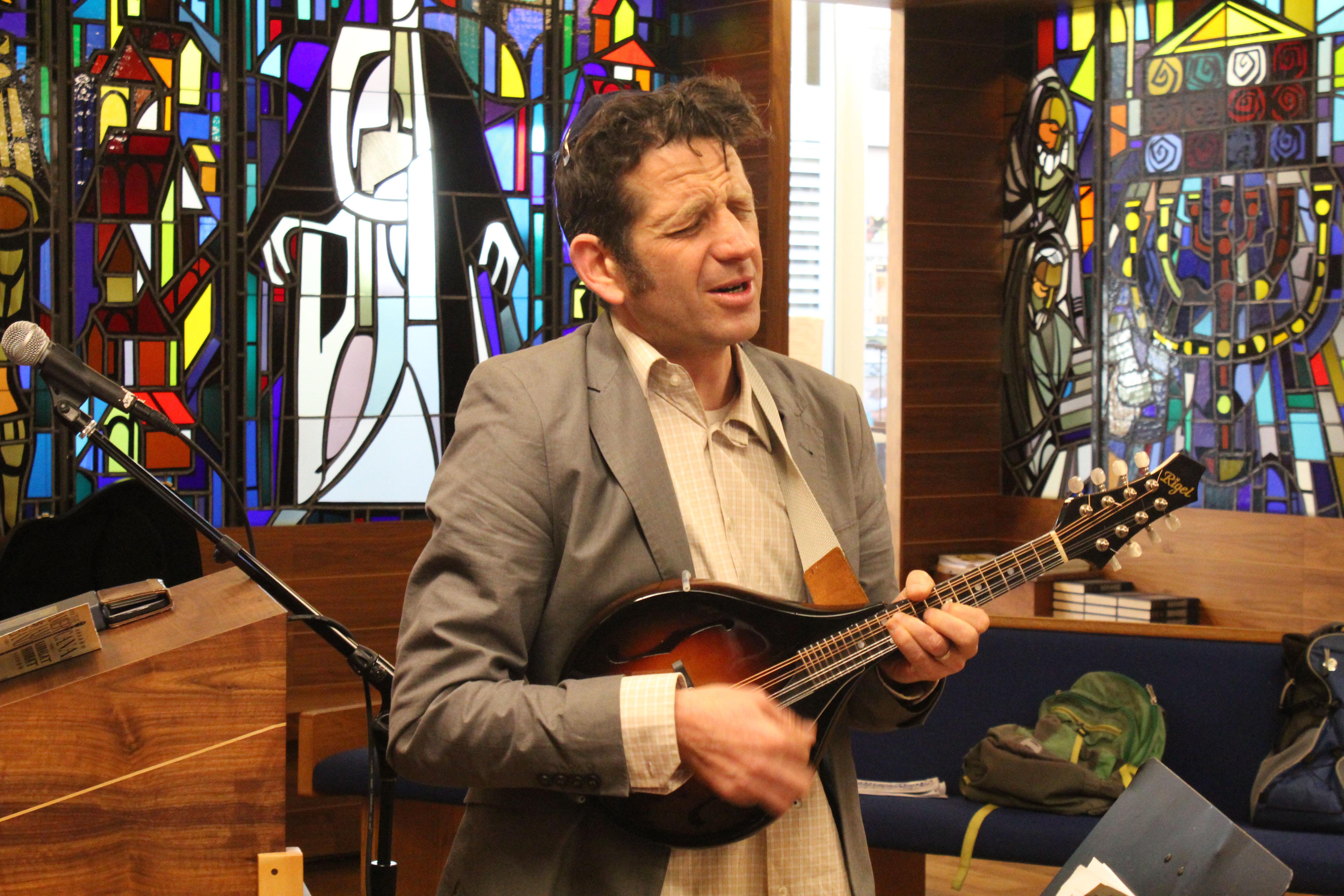 Bayer singing and playing mandolin