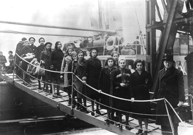 black and white -- long line of children disembarking a ship