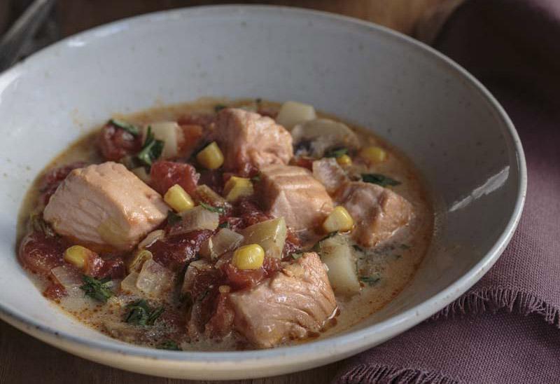bowl of soup with big chunks of salmon
