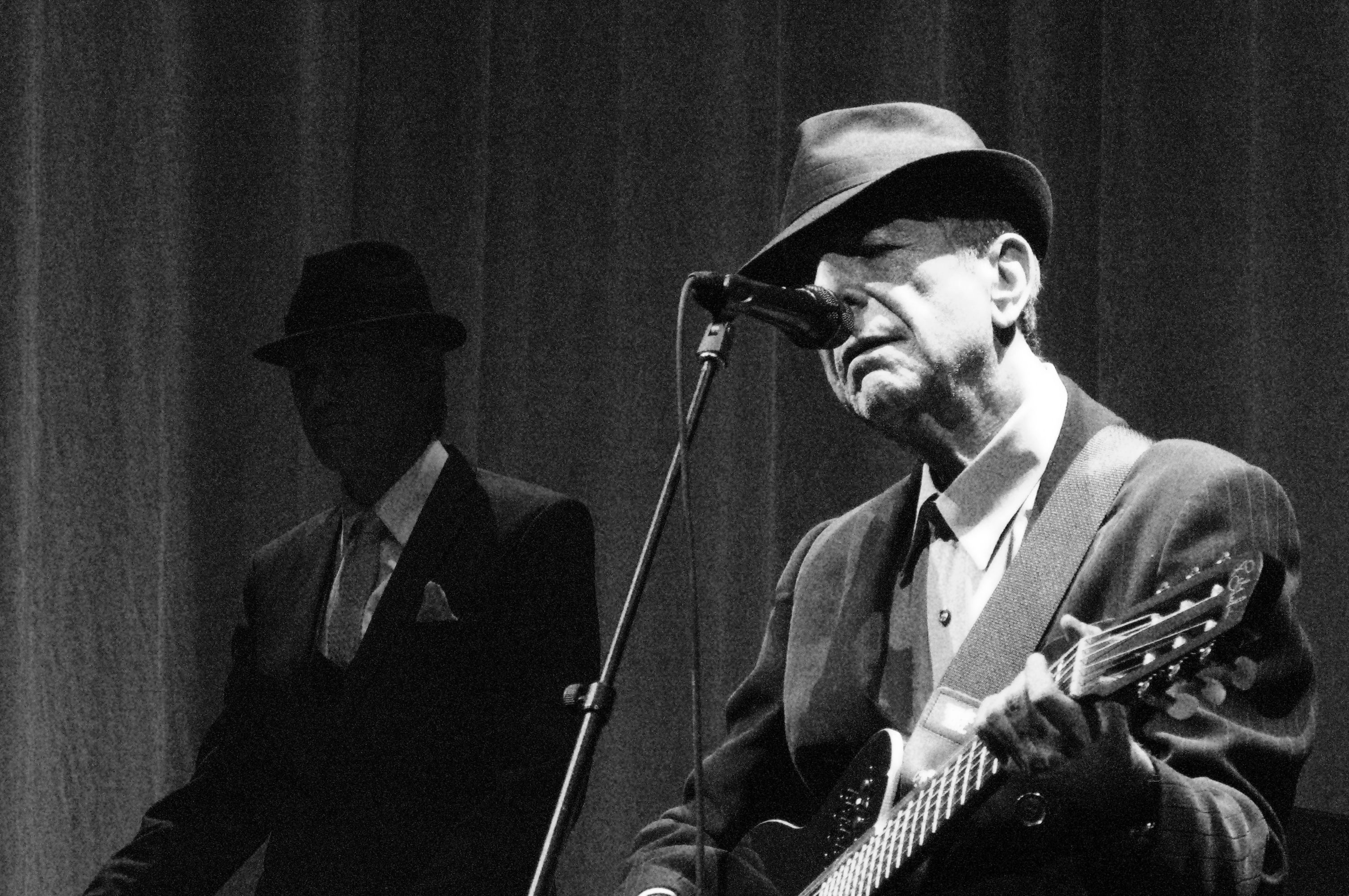 leonard cohen in a fedora on stage