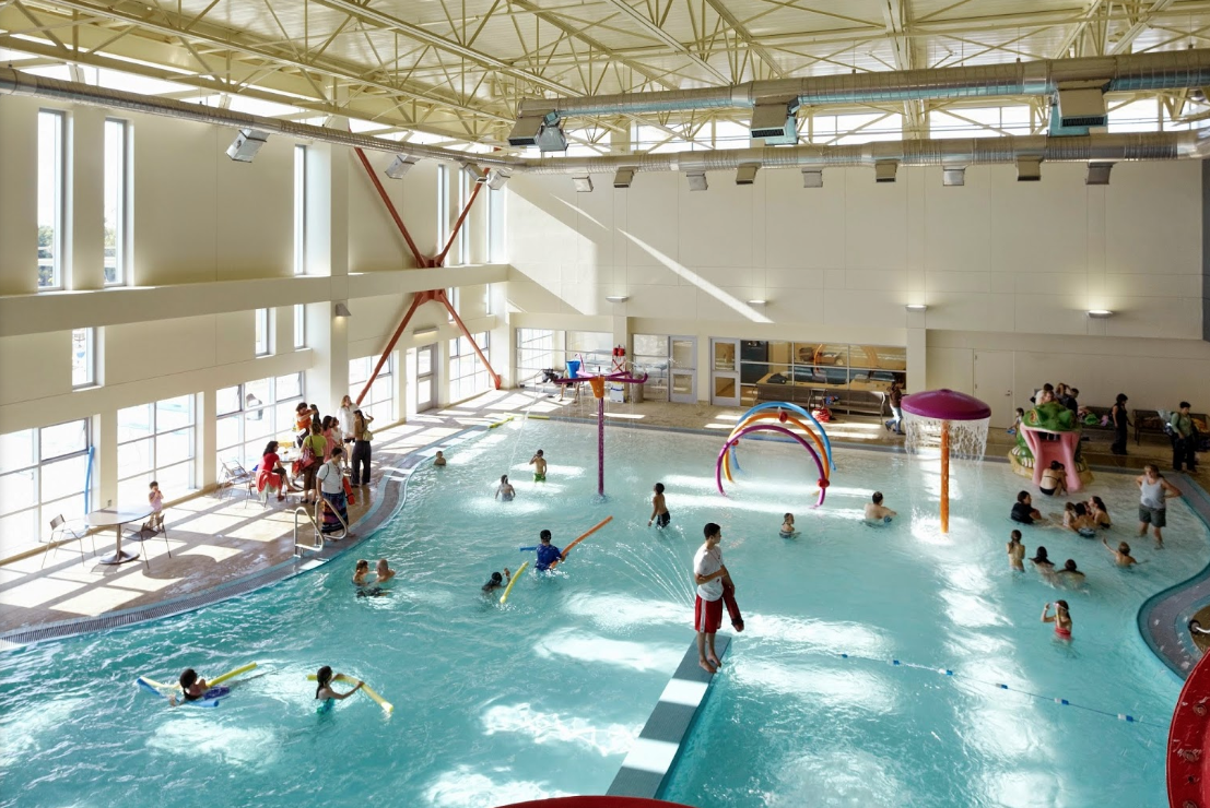 children playing in a large indoor pool