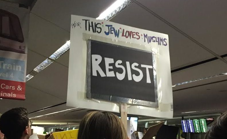 """sign reads: """"this jew loves Muslims — RESIST"""""""