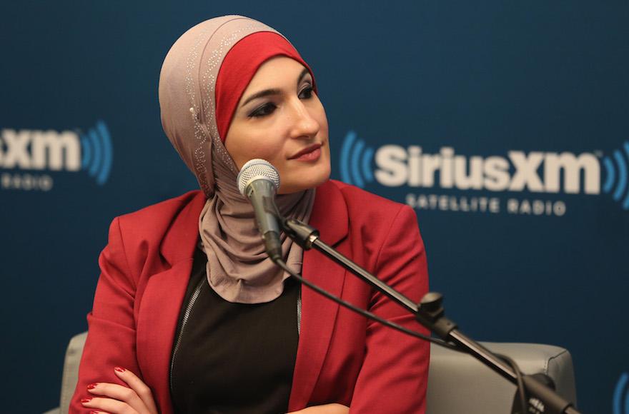 Sarsour speaking in a radio studio