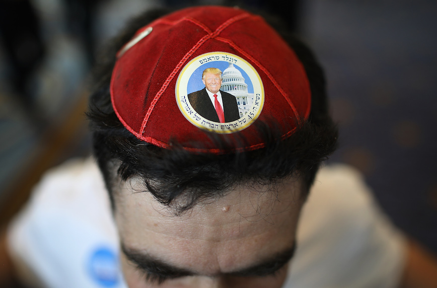a kippah that features a picture of trump and trump's name spelled out in hebrew