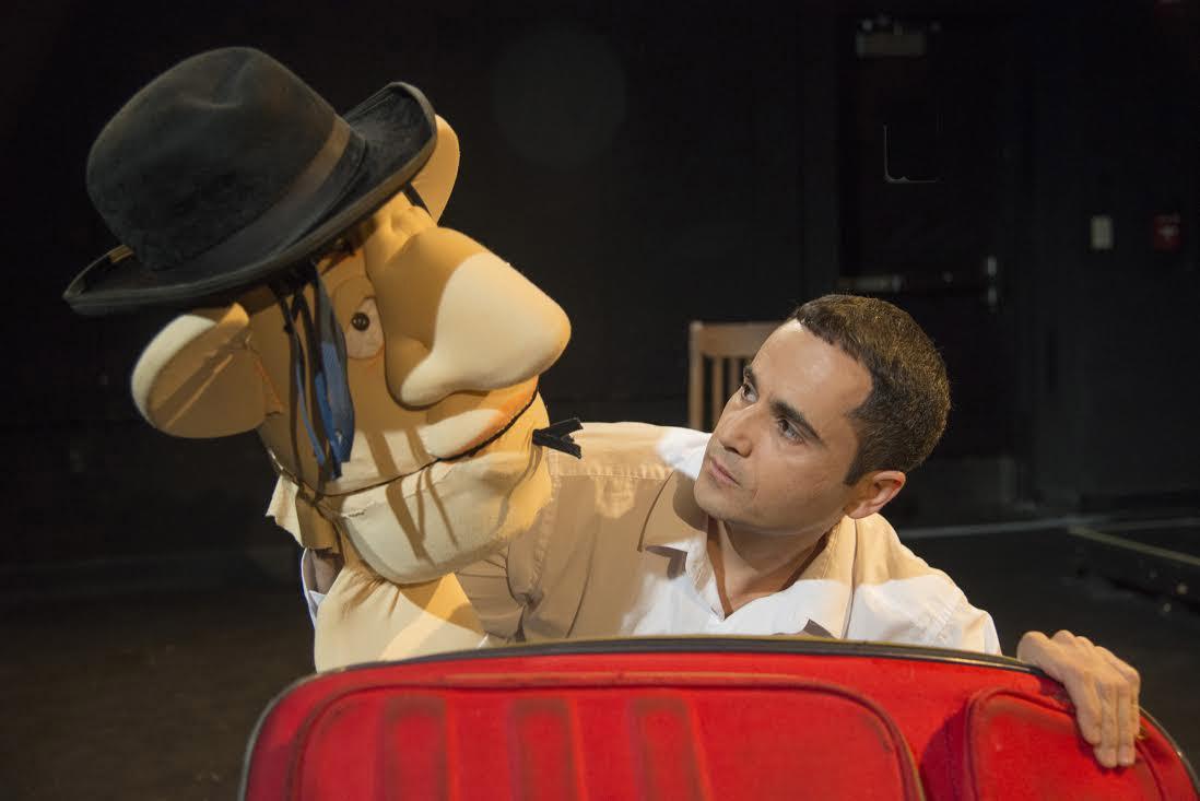 miari holds up an oversized puppet head