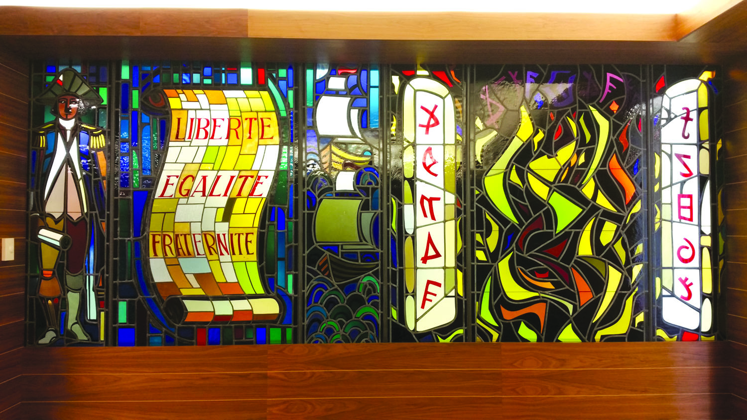 brightly colored stained glass of ten commandments