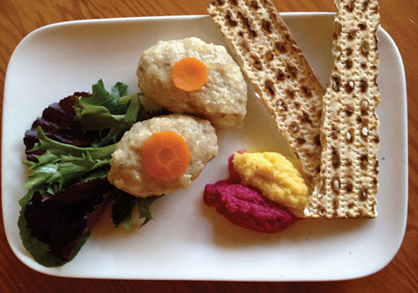 a plate with gefilte fish, maror and matzah