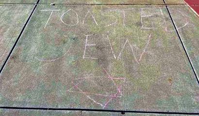 """""""Toasted Jew"""" written in chalk on a sidewalk at Carlton High School in Belmont"""