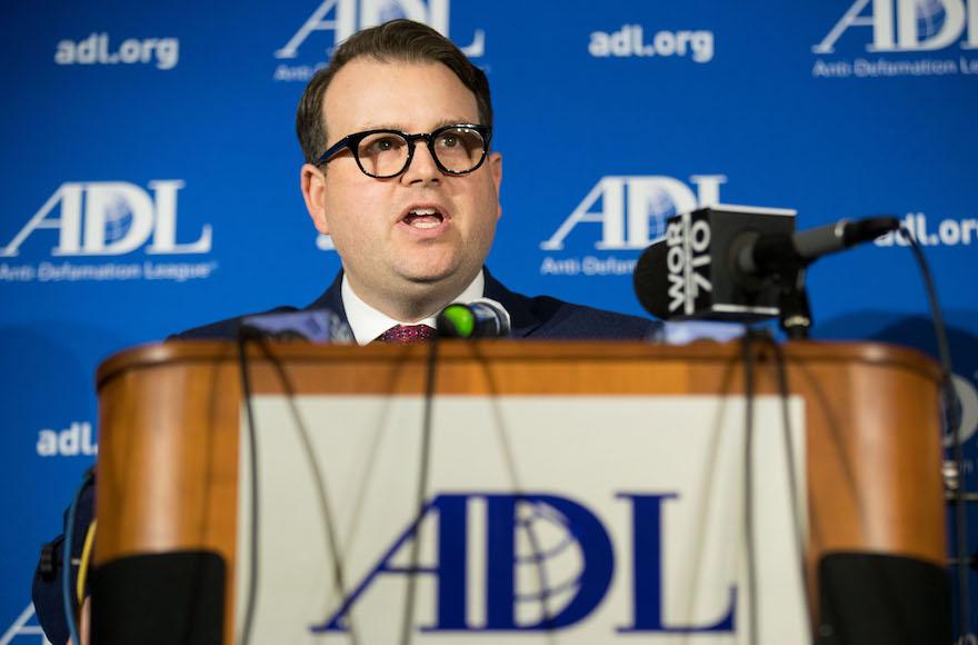 bernstein speaking at a podium