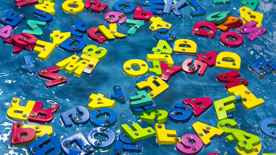colored letter toys scattered around