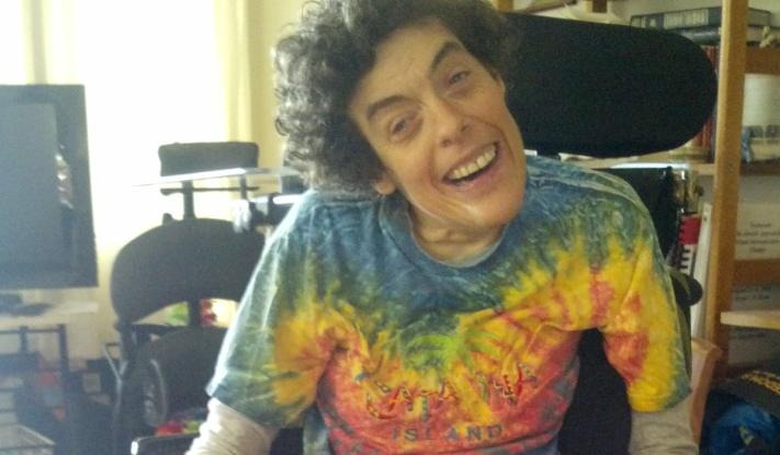 Gordon smiling in her wheelchair