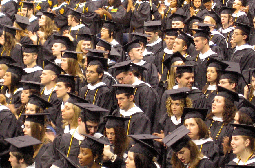 a sea of graduates in robes and mortarboards