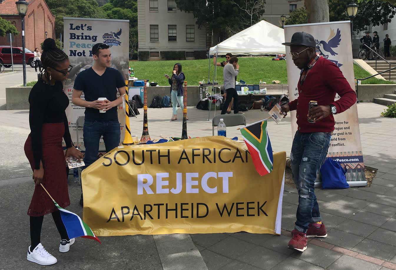 "they stand outside with a banner that says ""South Africans reject Apartheid Week"""