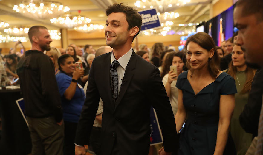 Ossof and Kramer make their way through a crowd of supporters