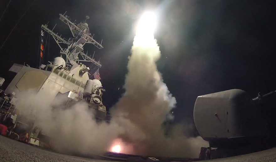 a low angle shot taken from the deck of a ship as it fires a missle