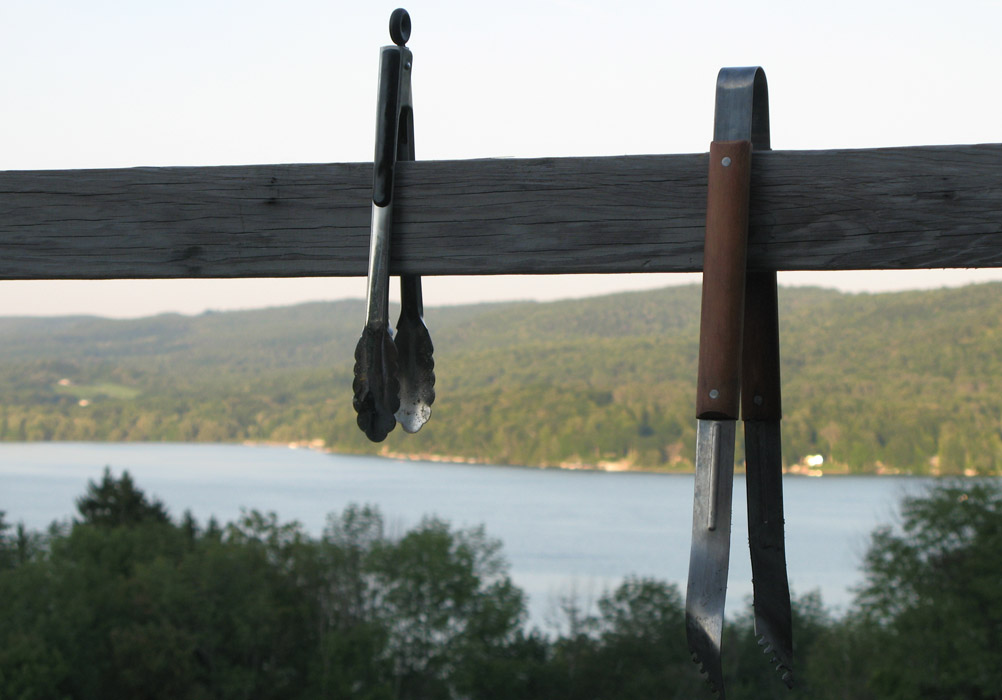 two pairs of tongs hanging from a beam