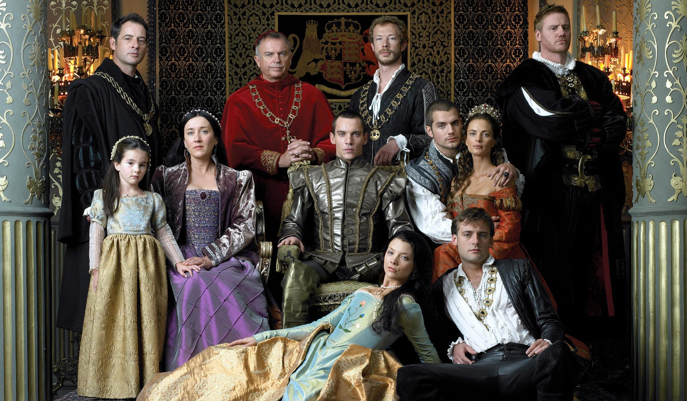 an image of the cast of the show, all dressed in period costumes