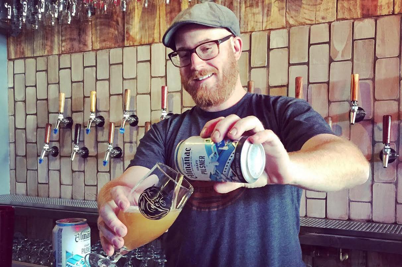 Cohen pours a beer