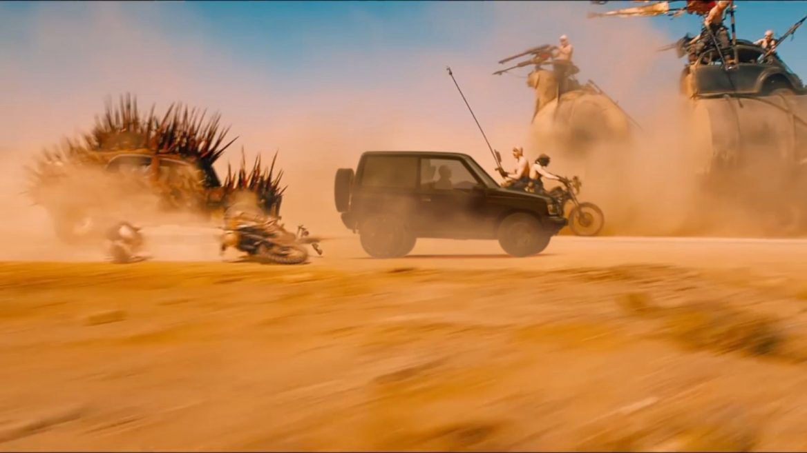 a Suzuki Vitara has been photoshopped into a race from Mad Max: Fury Road