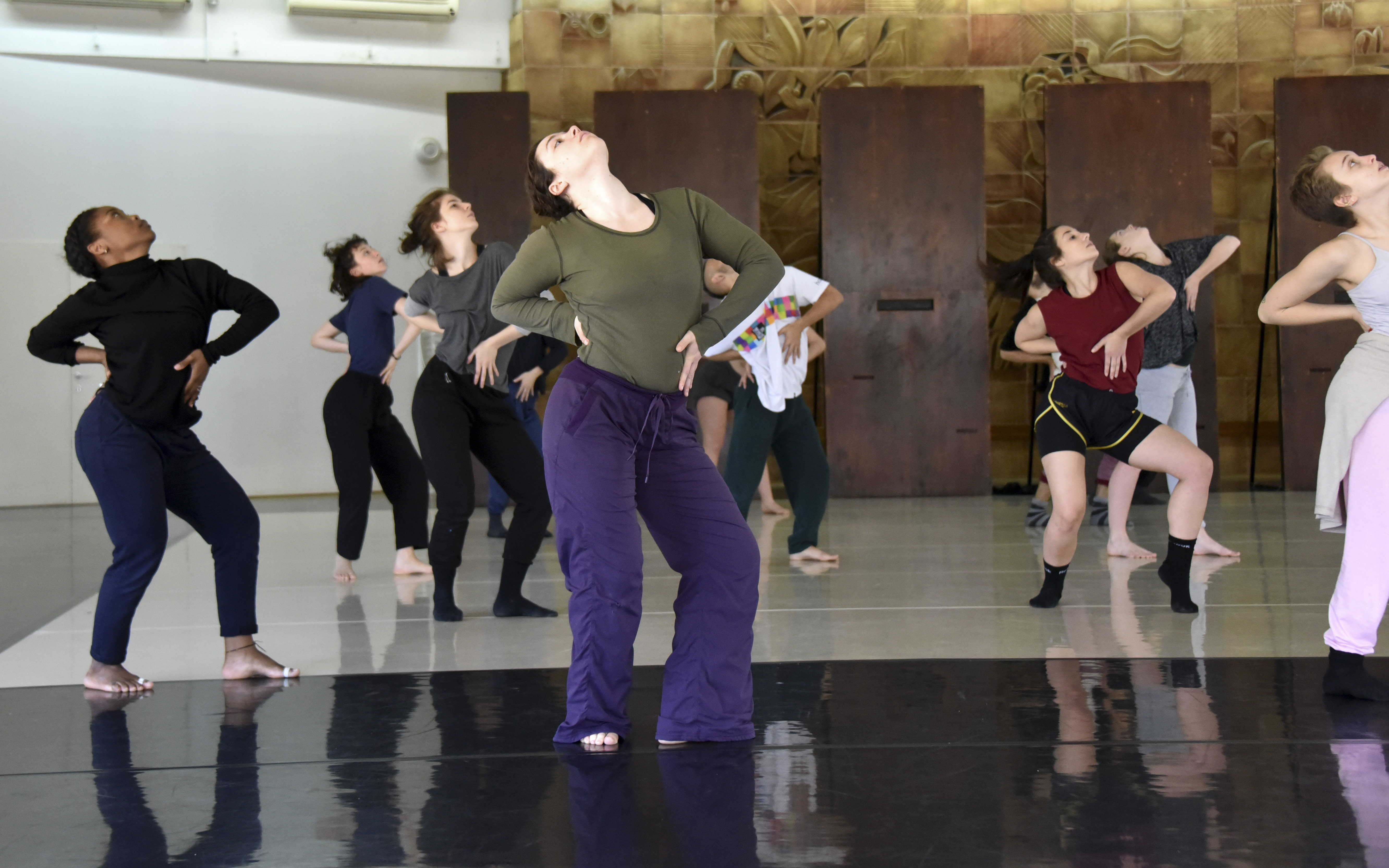 charlson and a room of other dancers strike the same defiant pose