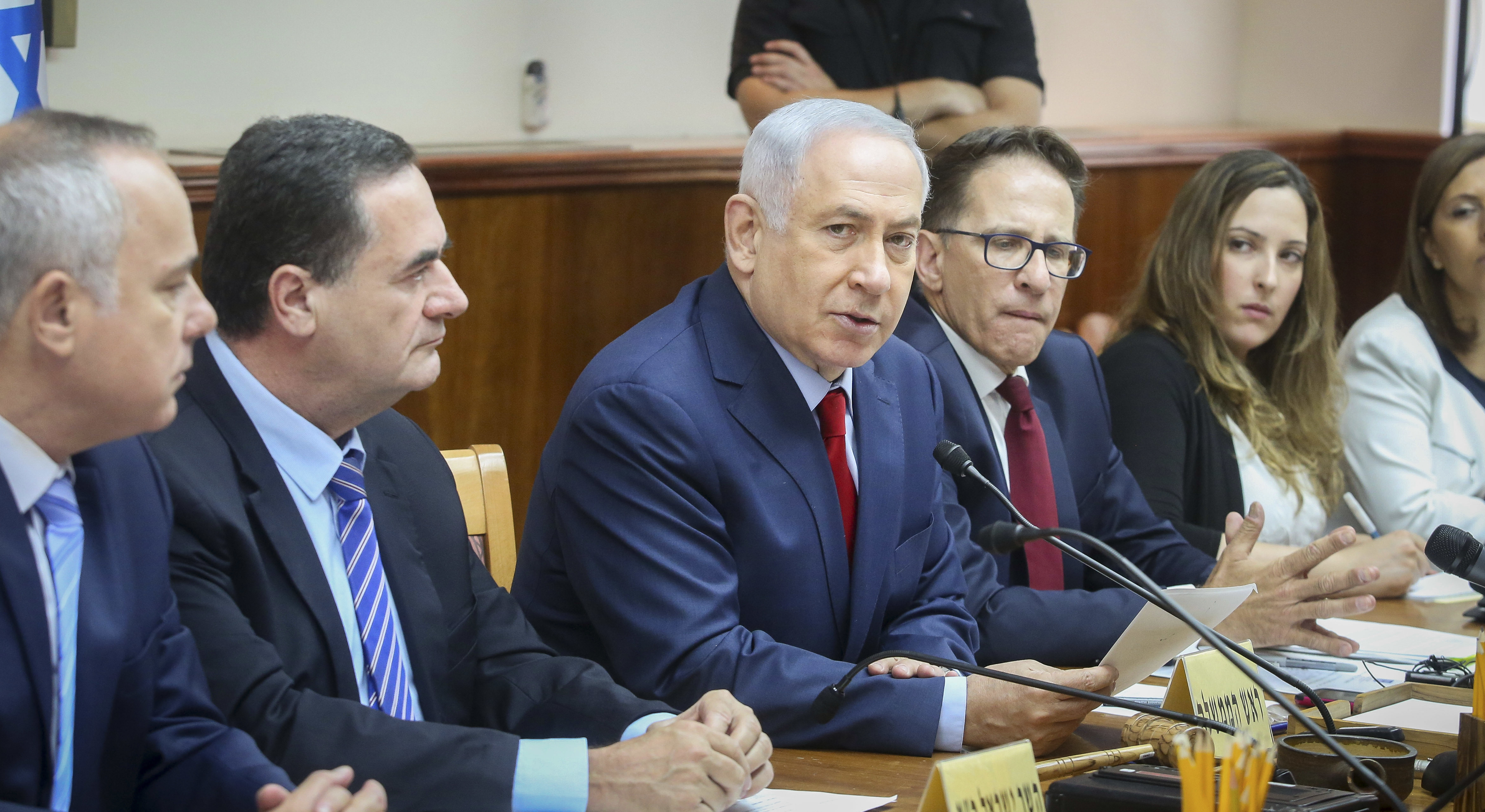 netanyahu sits at a table with other men