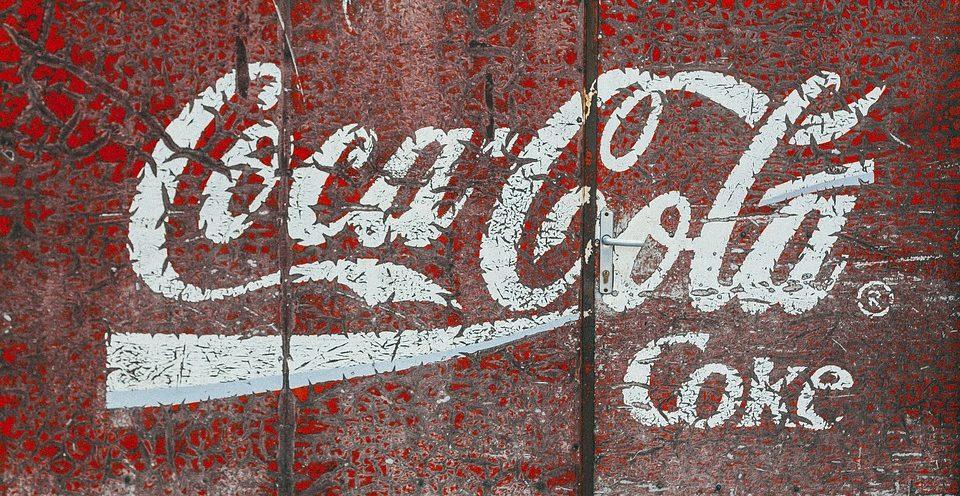 an antique coca-cola sign