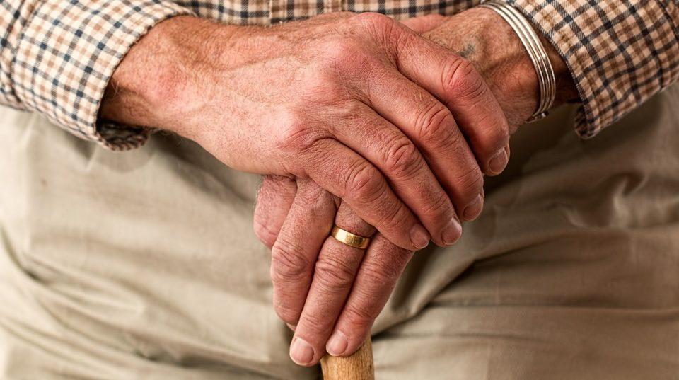 the hands of an elderly man