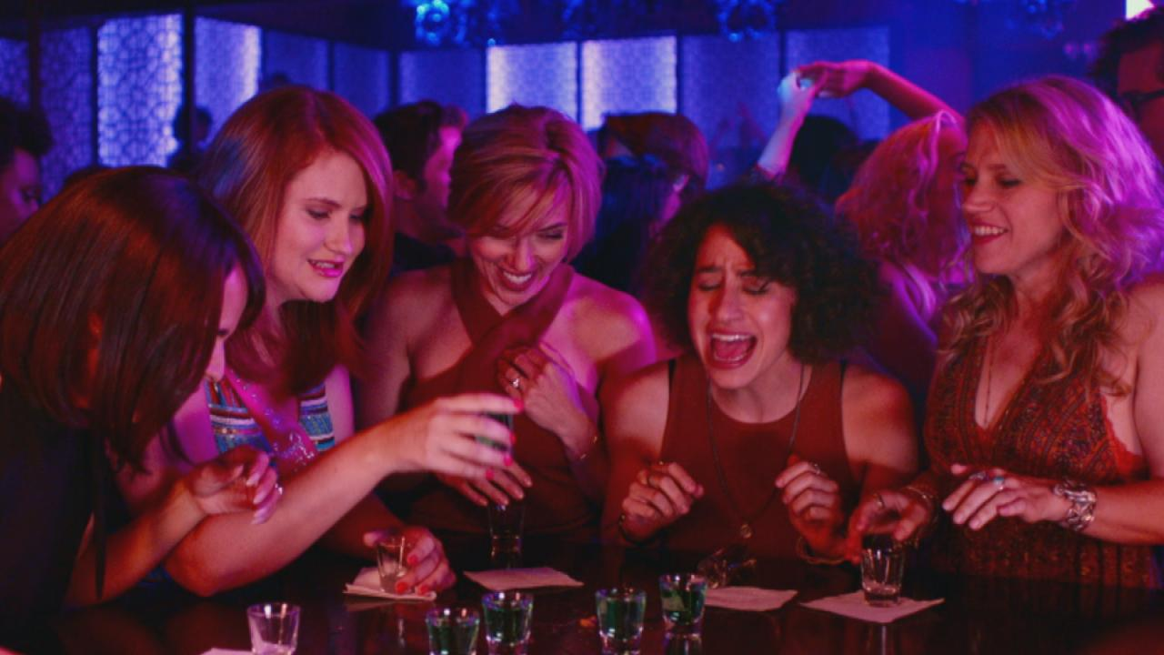 they're drinking shots in a night club
