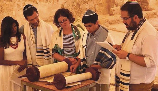 Sammy Paykel reads from the Torah as his parents Neela and Joe Paykel (from left), Rabbi Alissa Forrest Miller and Cantor Leigh Korn look on.