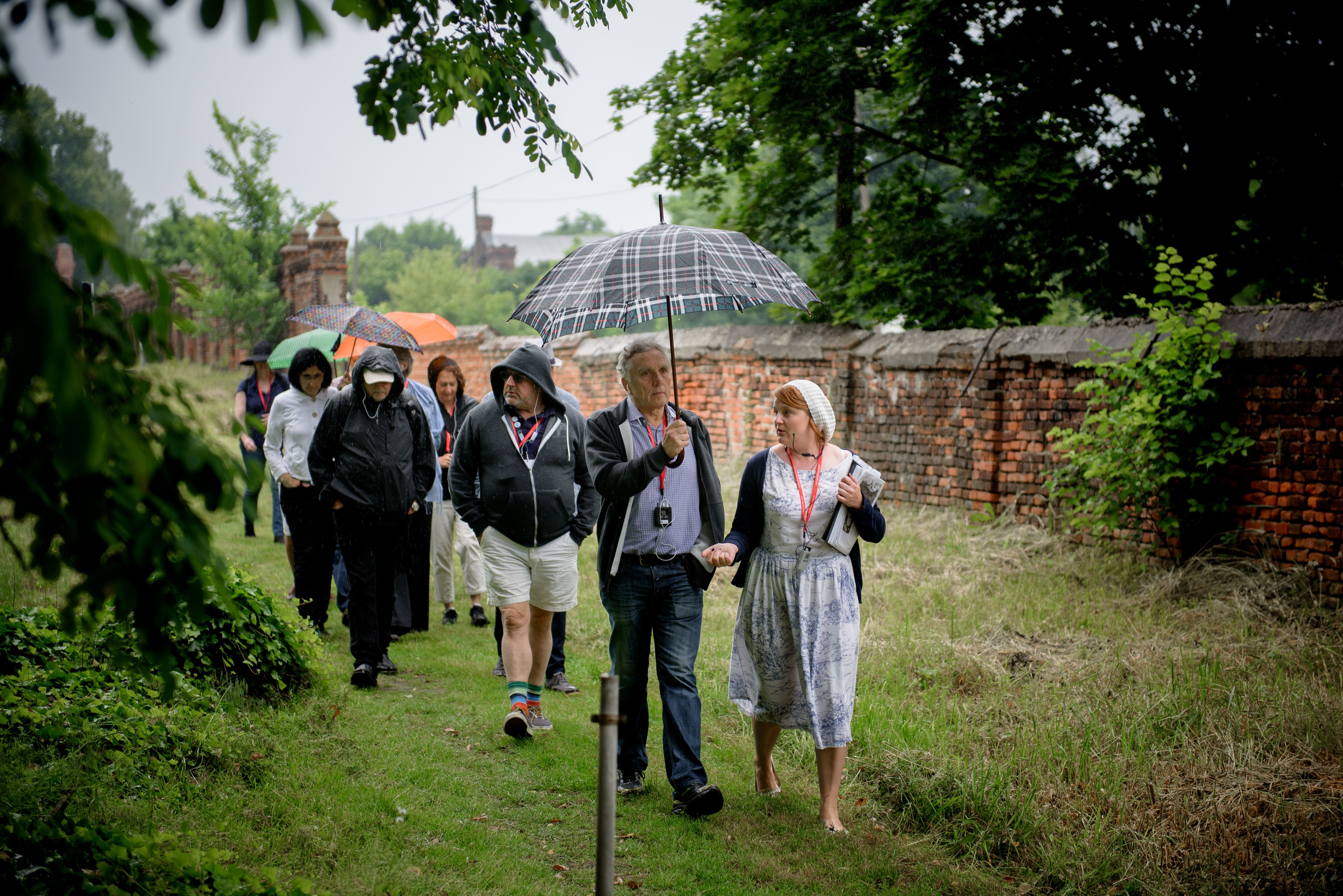 Moses Libitzky and a guide lead participants from the East Bay Federation trip through the Jewish cemetery on Lodz, Poland. (Photo/Courtesy Taube Philanthropies-Maciek Jazwiecki)