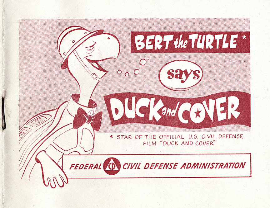 """cartoonish red turtle smiles near the words """"duck and cover"""" in large print"""