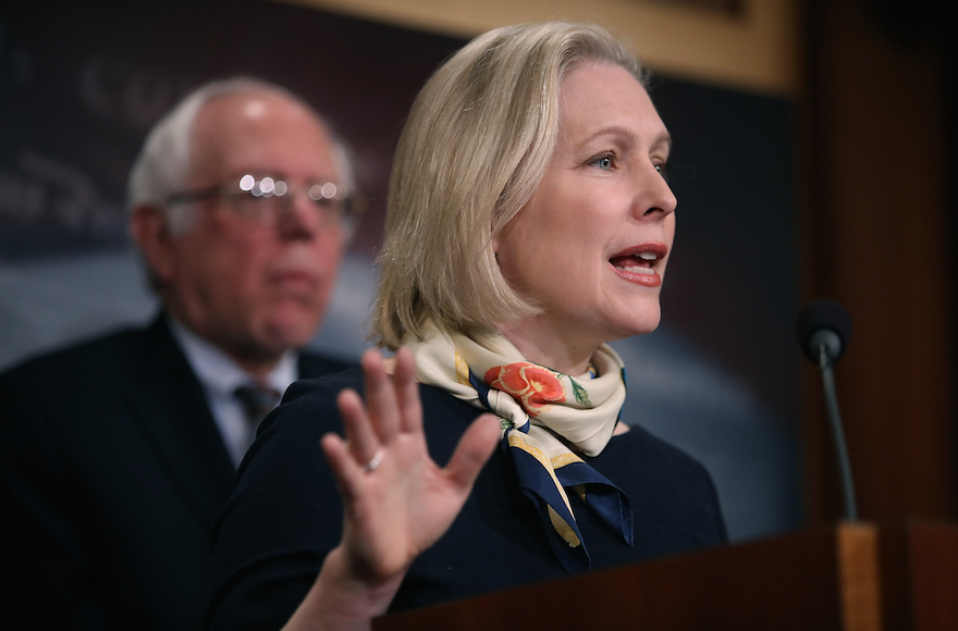 U.S. Sen. Kirsten Gillibrand (R) (D-NY) speaks as Sen. Bernie Sanders (L) (I-VT) looks on during a news conference at the U.S. Capitol on March 14, 2017 in Washington, DC. Senate Democrats annouced legislation to ensure American workers receive paid medical and family leave. (Photo by Justin Sullivan/Getty Images)
