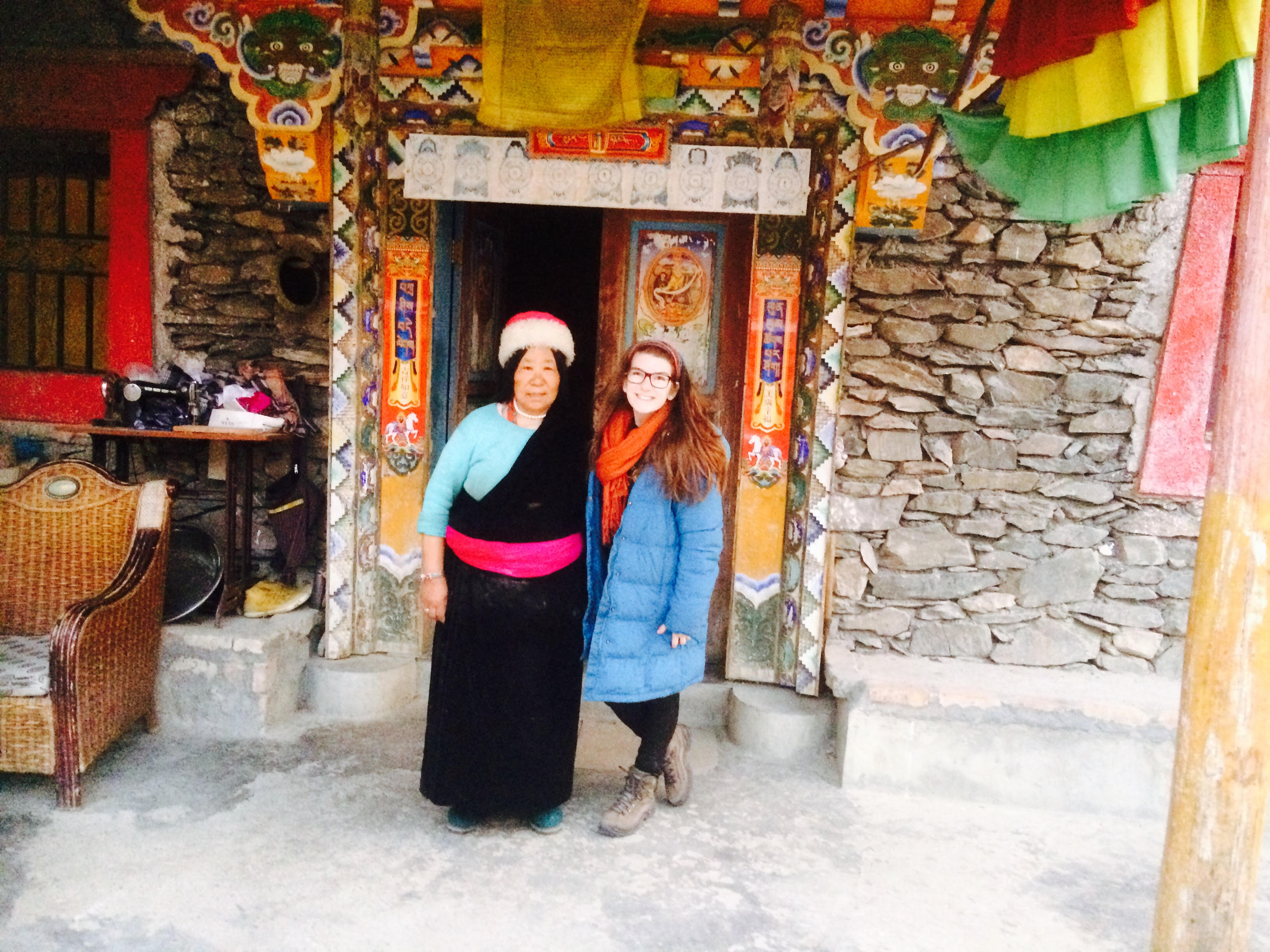Izzy Ullmann with the matriarch of a Tibetan family that helped her find a way to make Shabbat in China