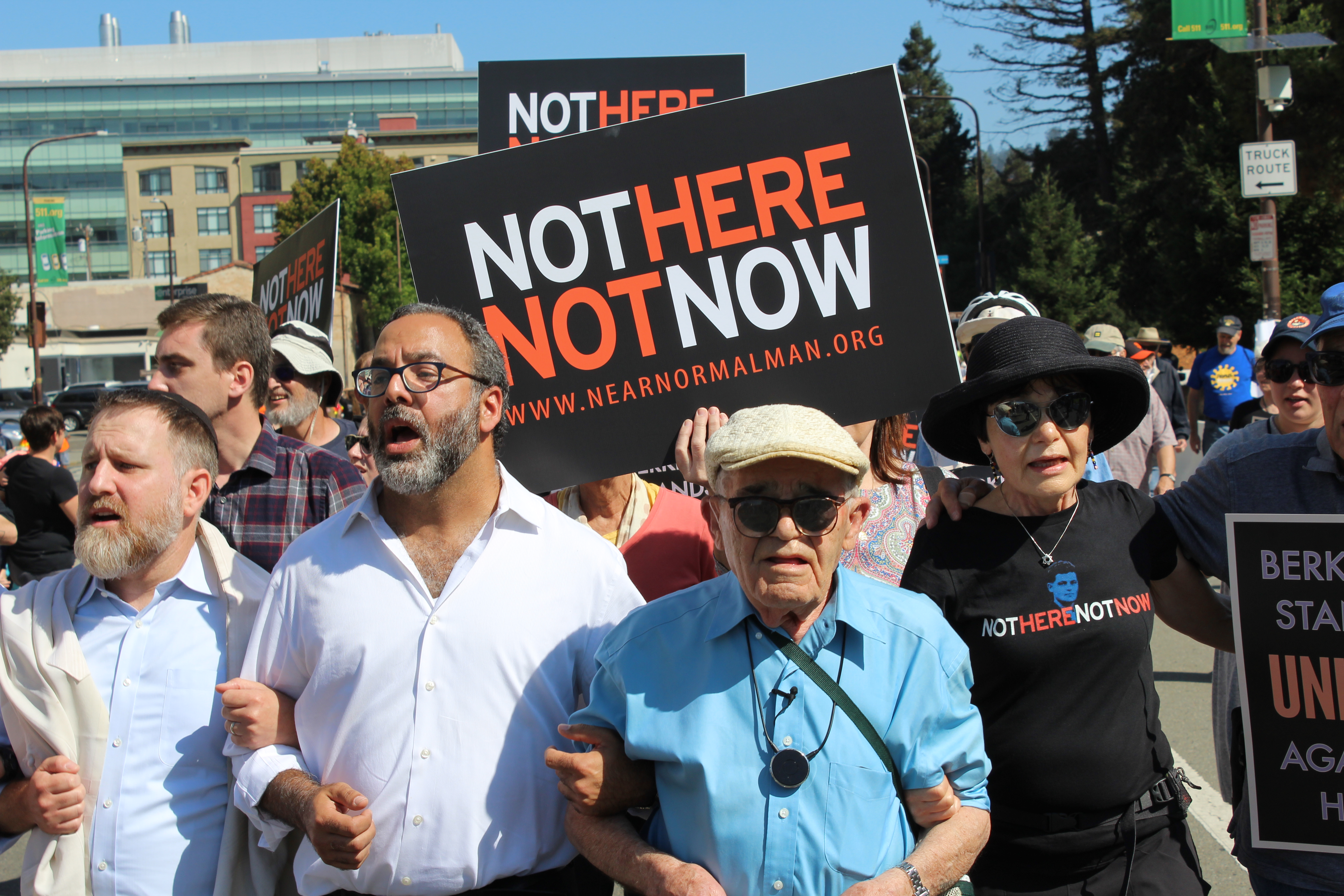 """Holocaust survivor Ben Stern (center, wearing blue shirt) leads about 200 marchers to the """"Bay Area Rally Against Hate"""" in Berkeley, accompanied by his daughter, Charlene Stern (on right), and Rabbis Menachem Creditor of Congregation Netivot Shalom (holding Ben's arm) and Yonatan Cohen of Congregation Beth Israel (far left), Aug. 27, 2017. (Photo/Rob Gloster)"""
