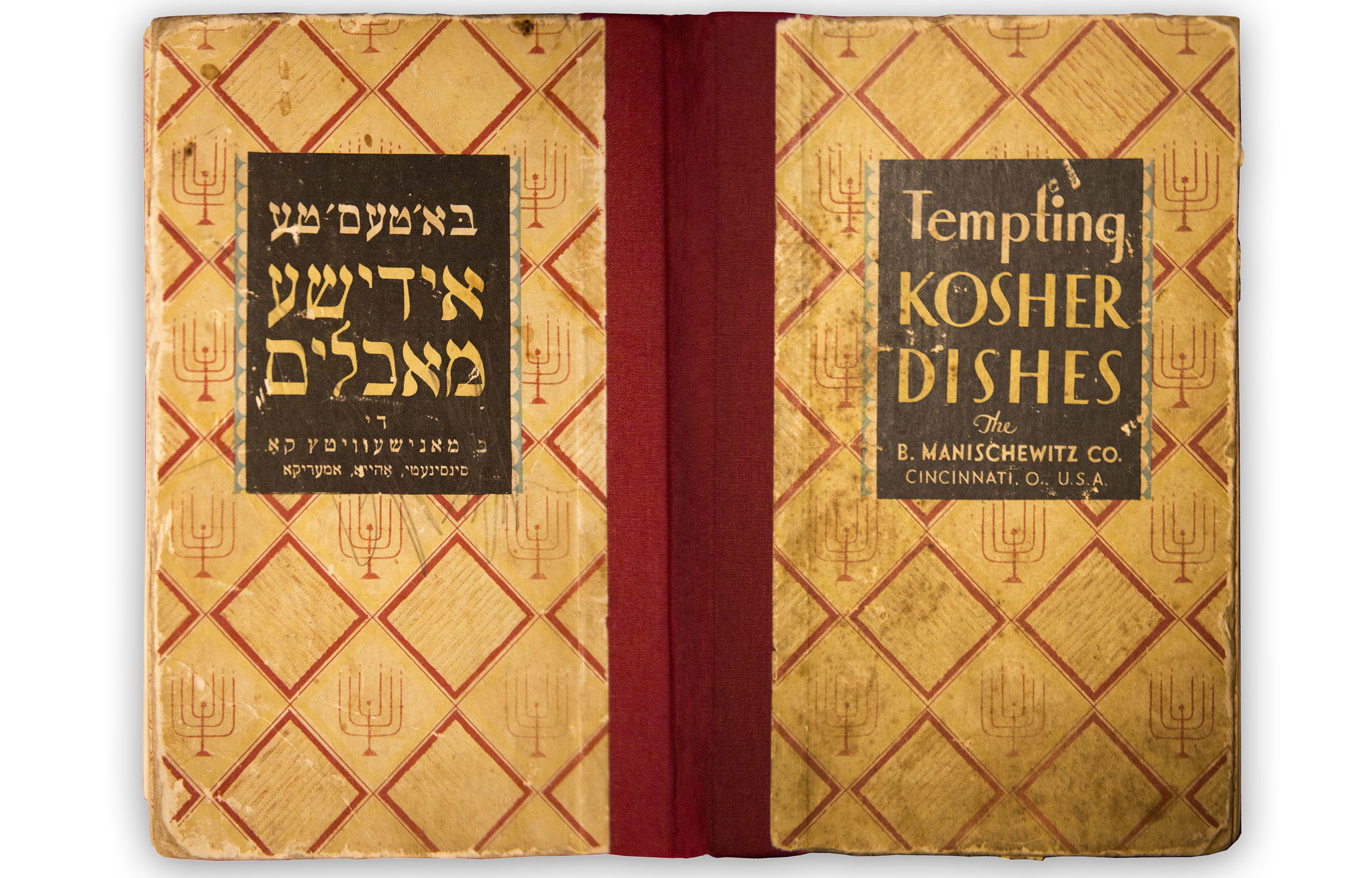 "A Yiddish-English 1930 Manischewitz kosher cookbook found in Roslyn Sholin's grandmother's house, now part of the ""My Attic, Your Story"" exhibit at Oshman Family JCC in Palo Alto"