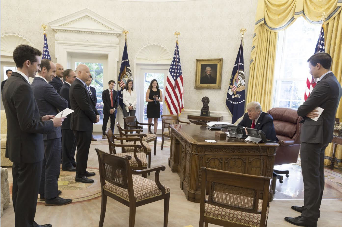 President Donald Trump speaking to Jewish leaders in a conference call at the White House as staffers look on, Sept. 15, 2017. (Photo/JTA-White House Press Office)