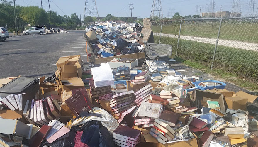Piles of ruined books from United Orthodox Synagogues of Houston. The congregation lost many of its prayer books and replenished them through donations. (Photo/Courtesy United Orthodox Synagogues of Houston)