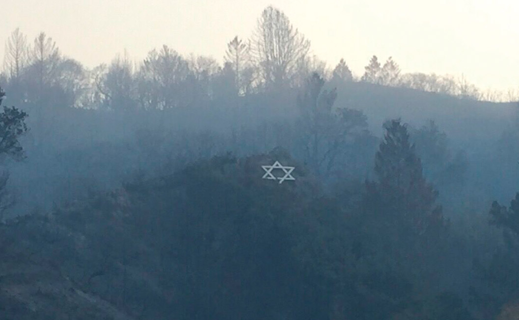 Surrounded by blackened vegetation, Camp Newman's iconic hillside Star of David, Oct. 2017, shortly after a wildfire devoured much of the camp. (Photo/Courtesy URJ Camp Newman)