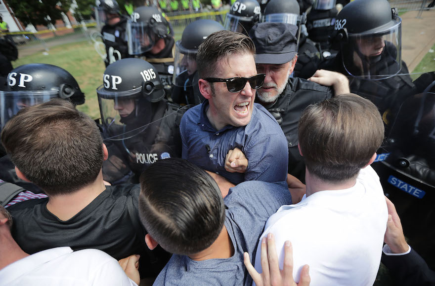 """White supremacist leader Richard Spencer, center, and supporters clashing with police in after the """"Unite the Right"""" rally was declared unlawful, in Charlottesville, Virginia, Aug. 12, 2017. (Chip Somodevilla/Getty Images)"""