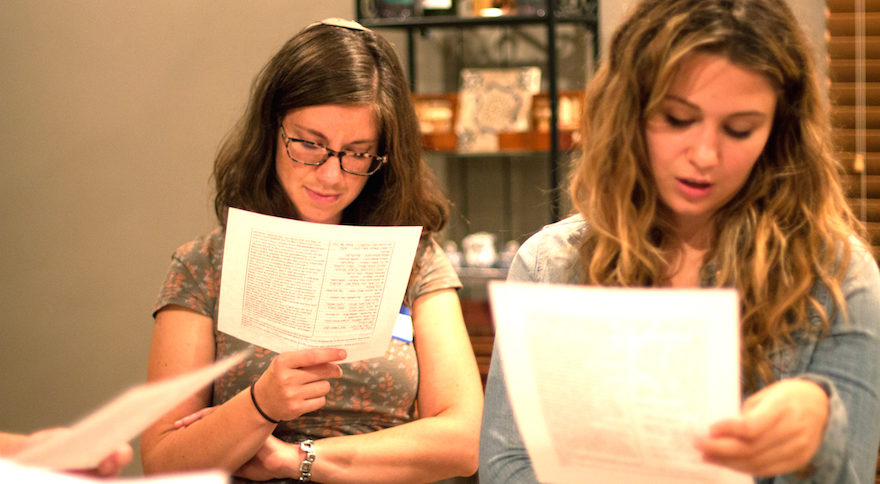 Rabbi Lauren Henderson (left) and another student look at source sheets at a Jewish learning session at Base Hillel Chicago, November 2016. (Photo/Couretsy Hillel International)