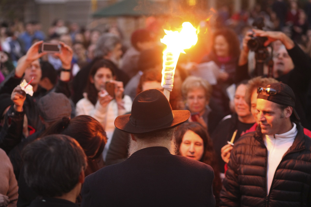 Rabbi Yosef Langer of Chabad of S.F. lights the Bill Graham menorah in Union Square in 2014. (Photo/Natalie Schrik)
