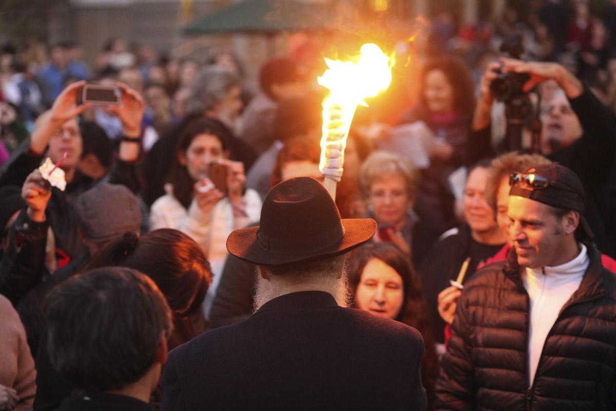 Rabbi Yosef Langer of Chabad of S.F. lights the Bill Graham menorah in Union Square in 2014. (Photo/Natalie Schrik)