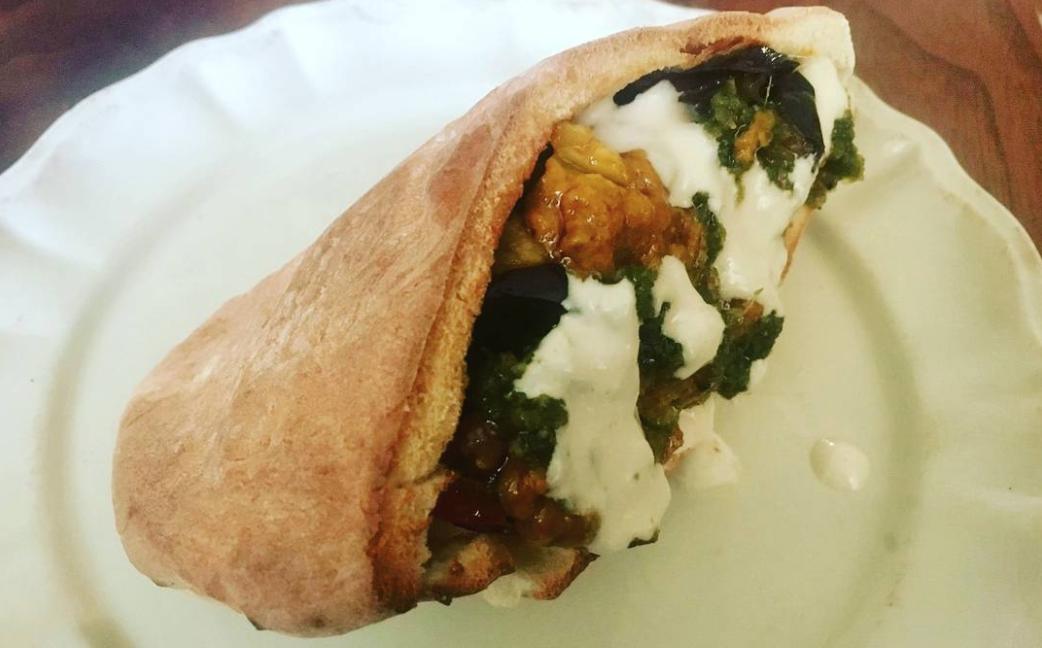 Sabich sandwich with all the fixins — tahini, haminado, zhug, etc.  (Photo/Shelly Butcher)
