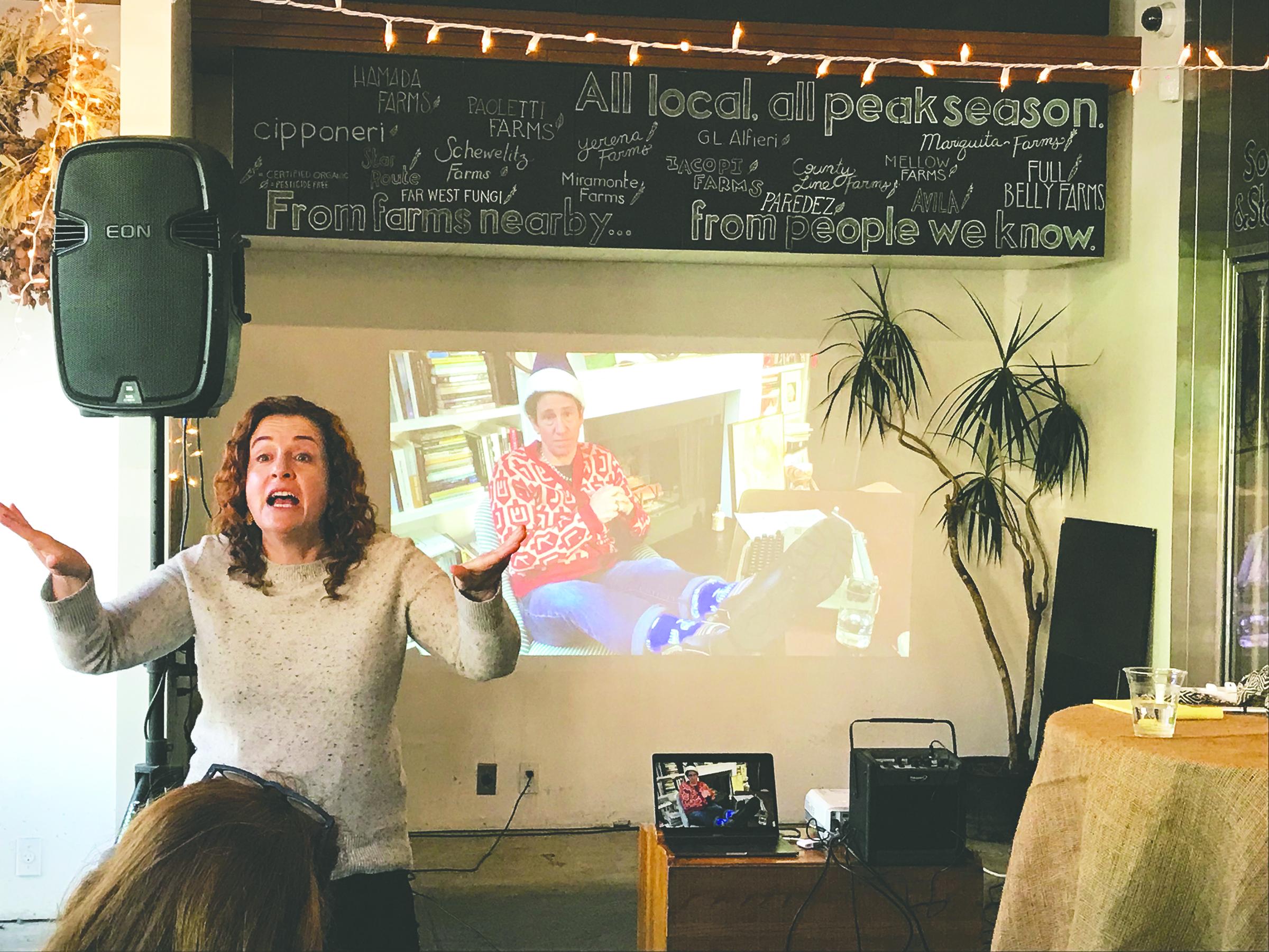 Ayelet Waldman argues the case against Hanukkah while Rabbi Sydney Mintz Skypes in. (Photo/Courtesy Reboot)