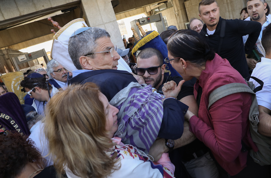 Rabbi Rick Jacobs, center, and other non-Orthodox Jews clashing with security guards at the entrance to the Western Wall plaza in Jerusalem, Nov. 16, 2017. (Photo/JTA-Noam Rivkin Fenton/Flash 90)